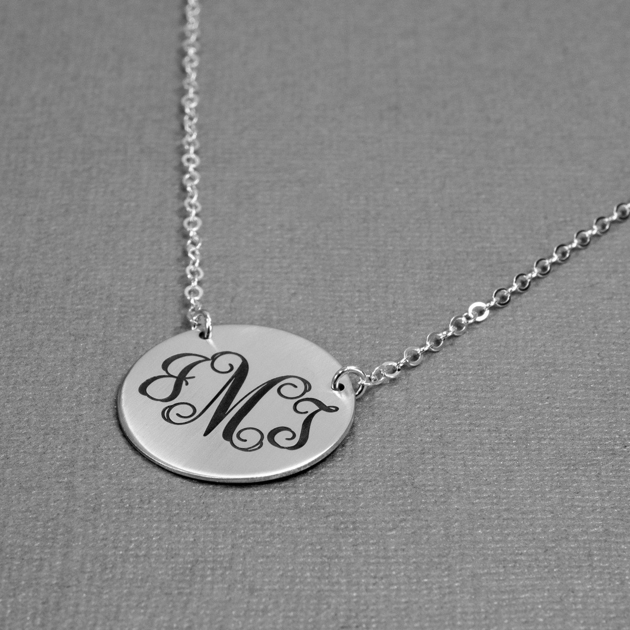 Silver monogram necklace, shown from side