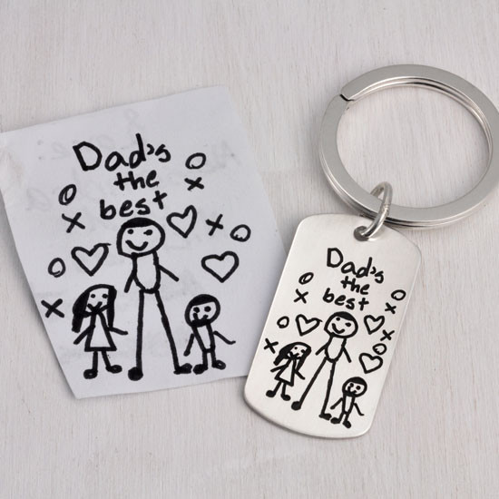 Handwritten note from kids on a silver key ring