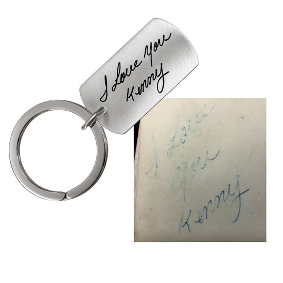 Faded handwriting used on a silver key ring