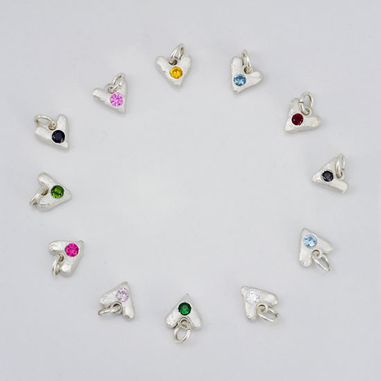 Sculpted Hearts Birthstone Charms in fine silver, showing all months, from another angle