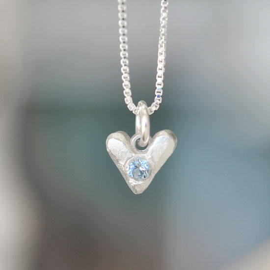 Sculpted Hearts Birthstone Charm in fine silver, close up showing birthstone, with charm on a sterling silver chain