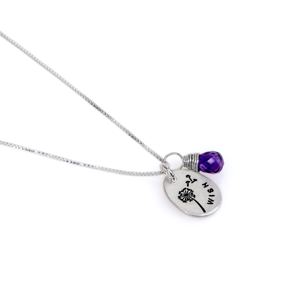 Fine silver wish necklace with birthstone with stamped dandelion, shown close up on white