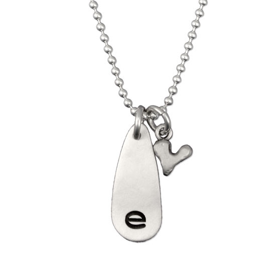 E stamped on tear drop charm