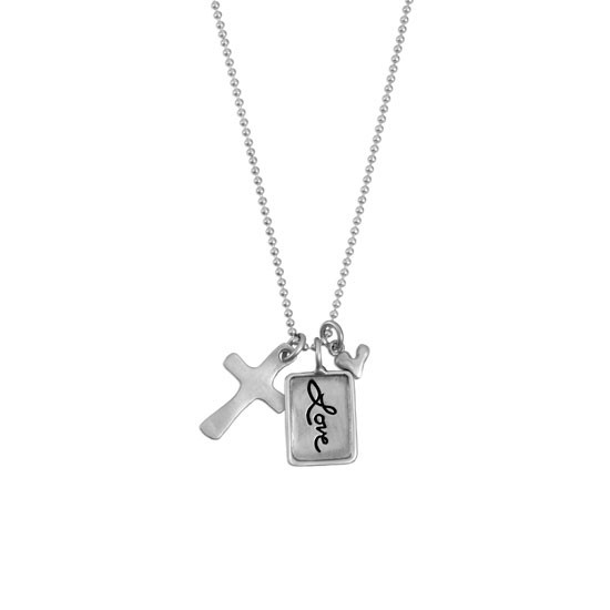 Silver charm with raised edge & the handwritten word Love, with a fine silver cross and fine silver heart, shown on white