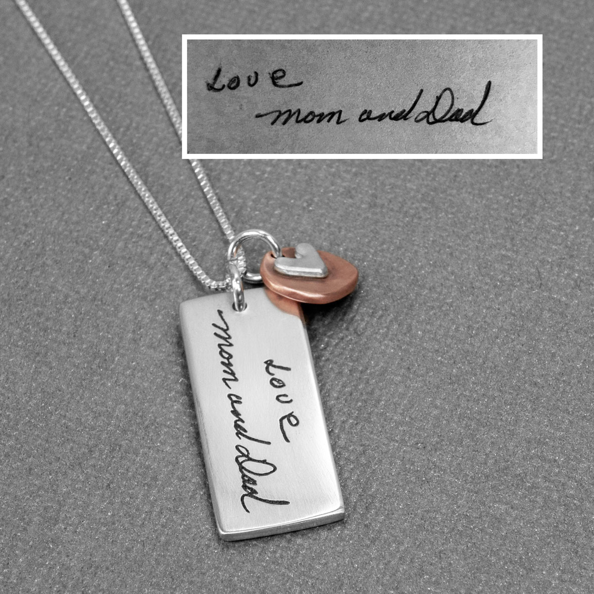Sculpted Handwriting Silver Necklace with Copper Heart Charm, shown with original handwritten note used to create it