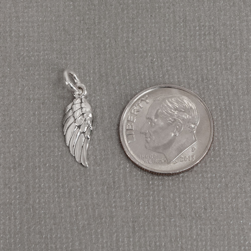 Silver Angel wing to add to your hand stamped or handwriting memorial necklace or bracelet, shown next to a dime
