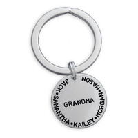 Silver custom hand stamped key ring for grandma with grandkids' names, shown on white