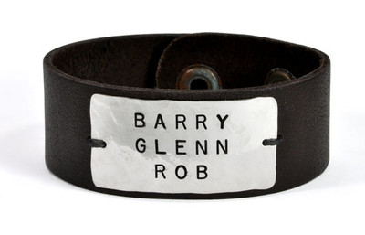 Hand Stamped Leather Bracelet for Him, with the names Barry Glenn Rob, shown on white