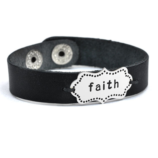 "Hand stamped leather cuff shown with word ""faith"""