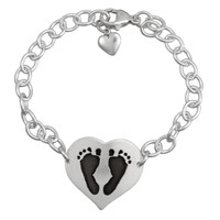 Custom silver heart bracelet personalized with your child's actual footprints, shown on white