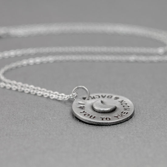 Hand stamped to the moon pendant with raised moon from the side, on gray