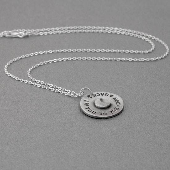 Hand stamped to the moon pendant with raised moon from 45 degree angle