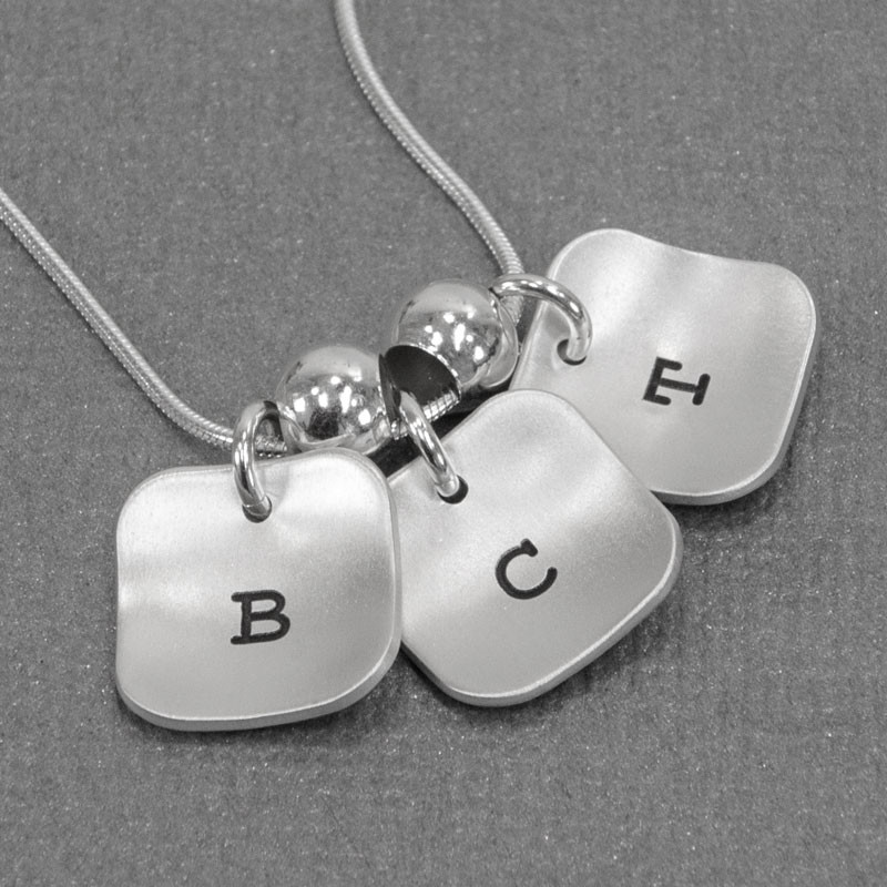 hand stamped brushed silver squares initial necklace, shown close up