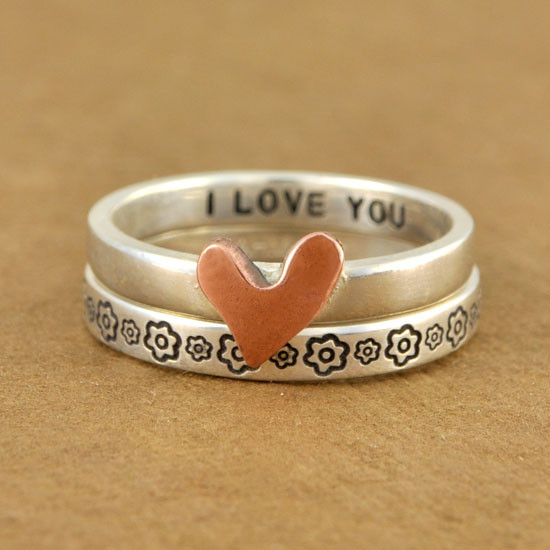 Flower ring stacked with our copper heart ring