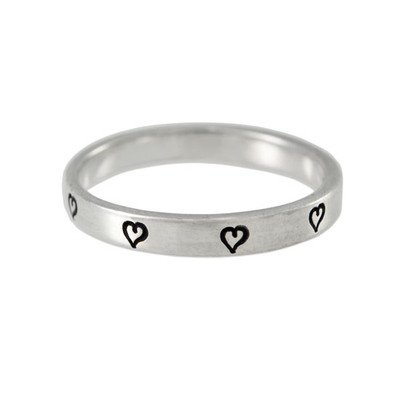 Ring stamped with tiny heart
