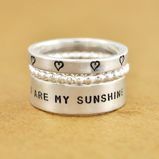Hand stamped you are my sunshine ring paired with other rings