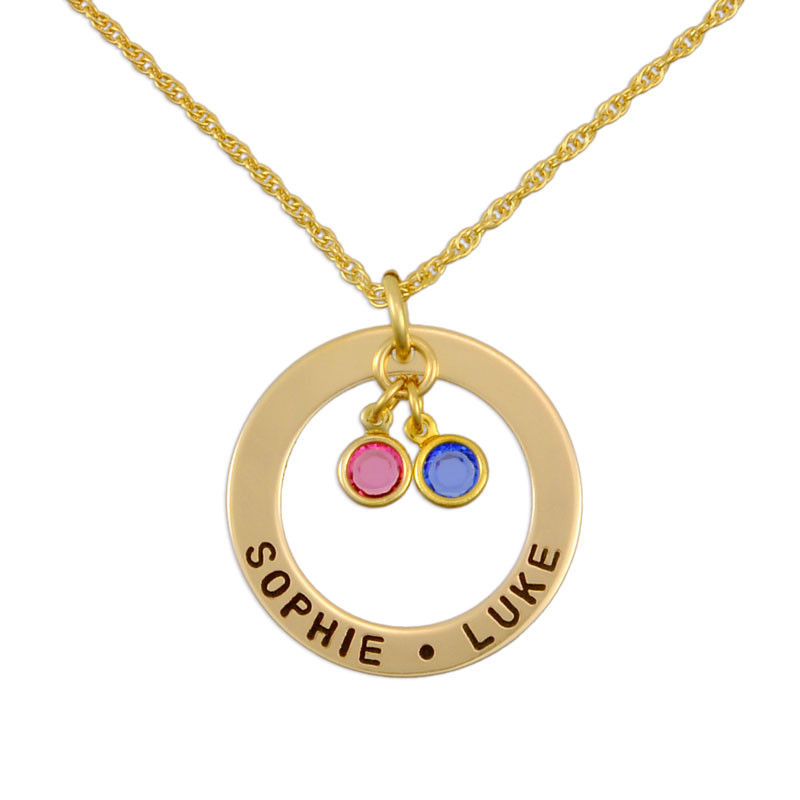 Gold custom hand stamped circle necklace personalized with kids names and Swarovski birthstones, shown on white