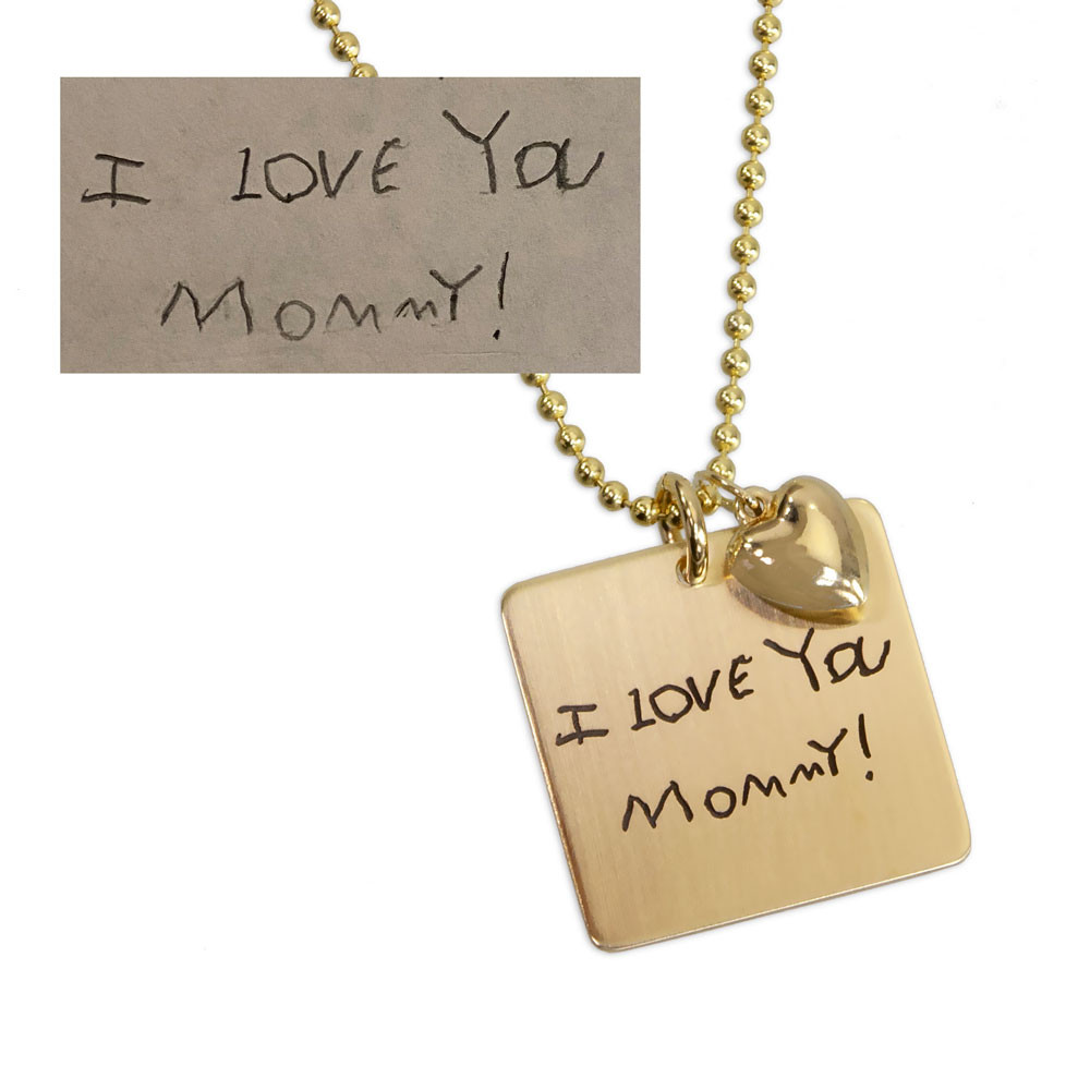 Custom Gold charm necklace with handwriting, shown with original handwritten note used to create it