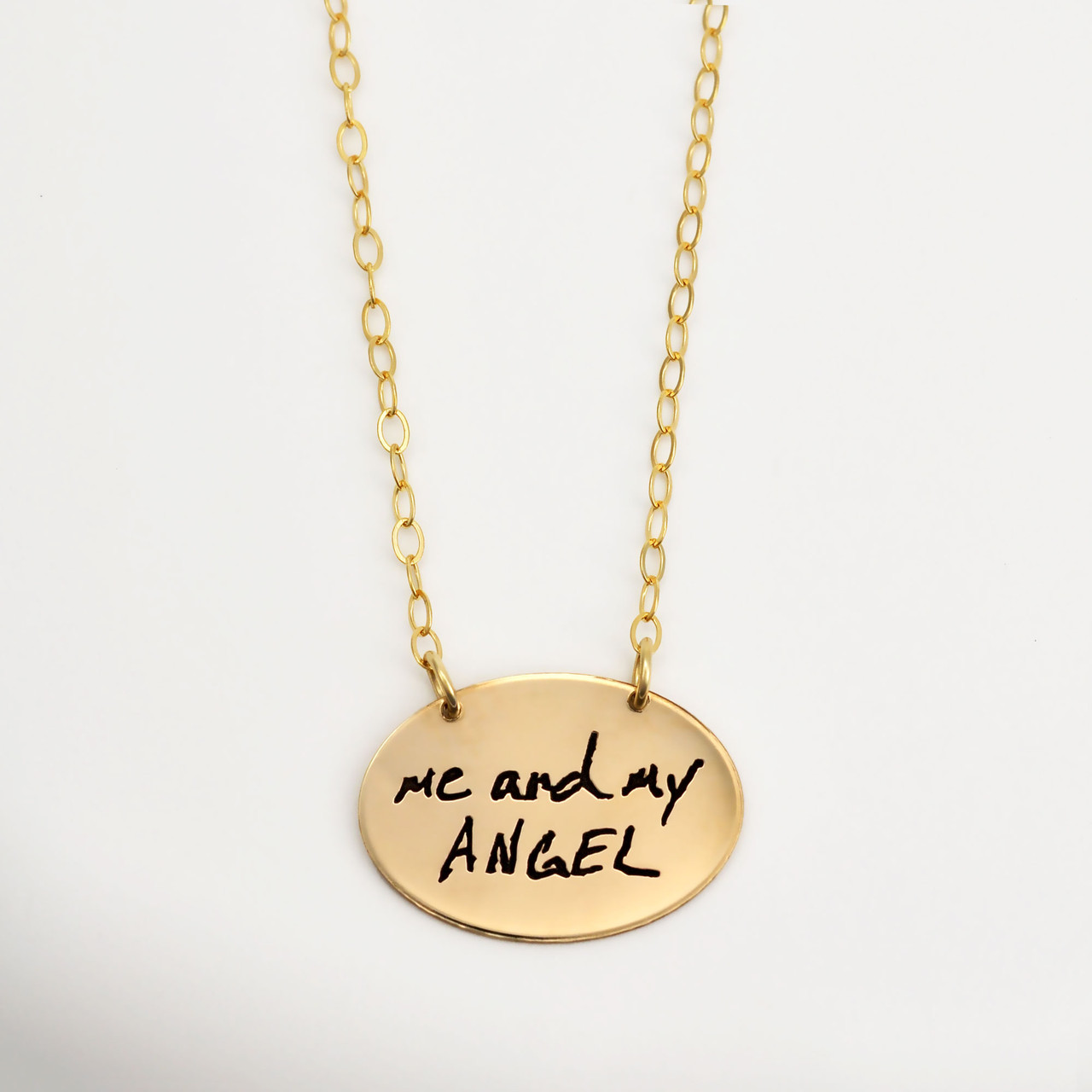 Gold oval necklace with your actual handwriting, shown on white