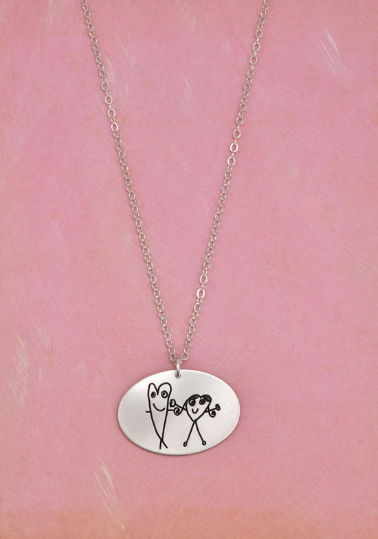 Silver oval charm necklace with kid's artwork, on a silver chain, shown on pink background