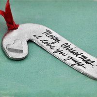 Handwriting personalized ornament in fine pewter, shown from the side