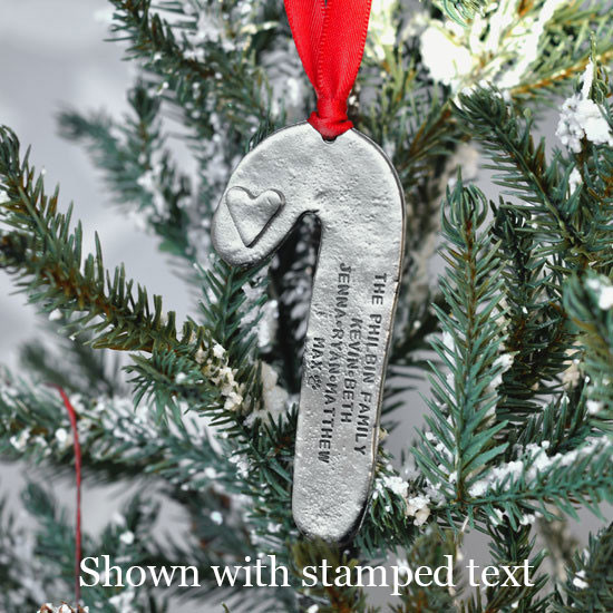 Personalized candy cane fine pewter ornament, shown on a tree