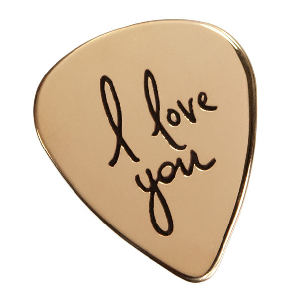 Gold personalized guitar pick with actual handwriting saying I Love You