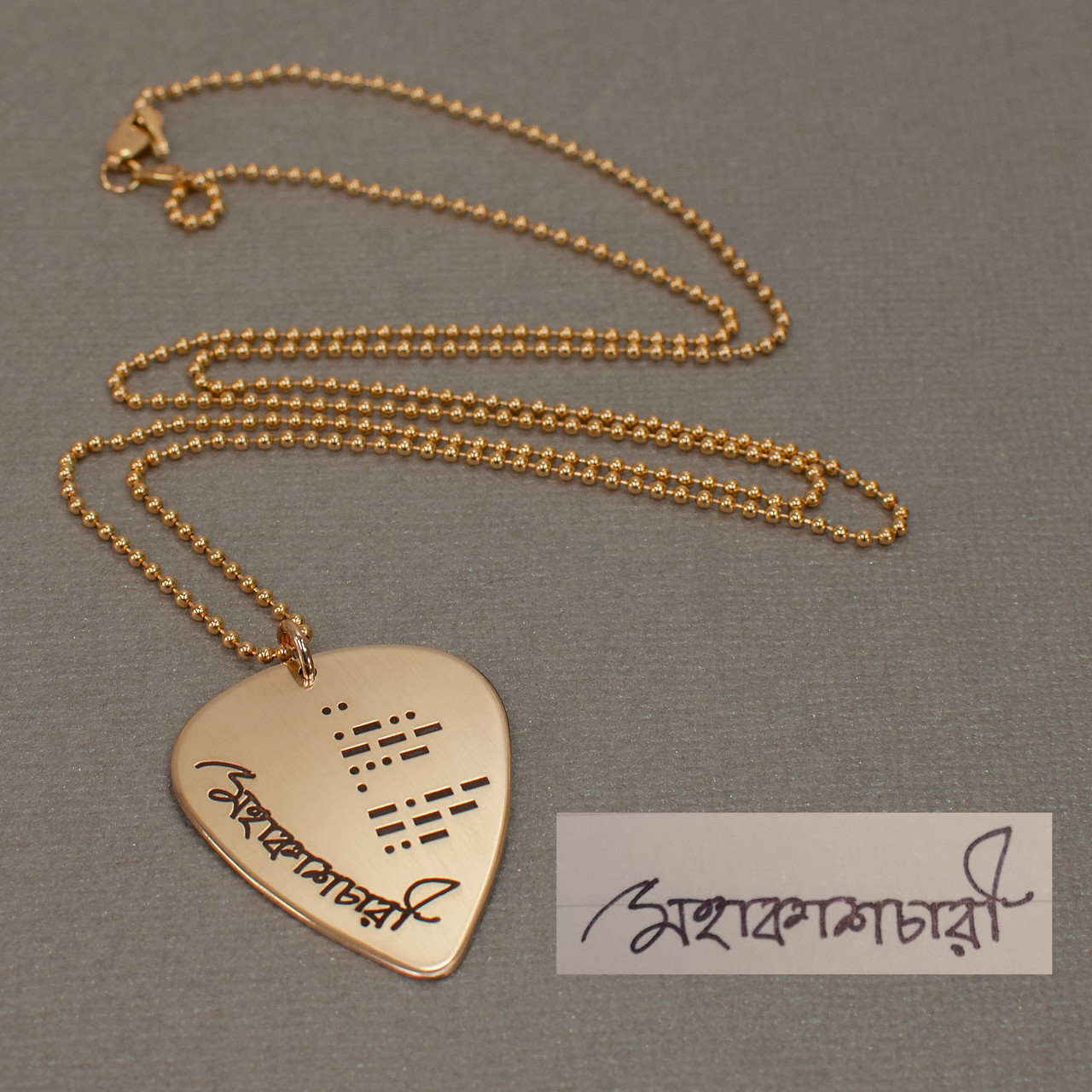 Gold guitar pick necklace with actual handwriting, with morse code message