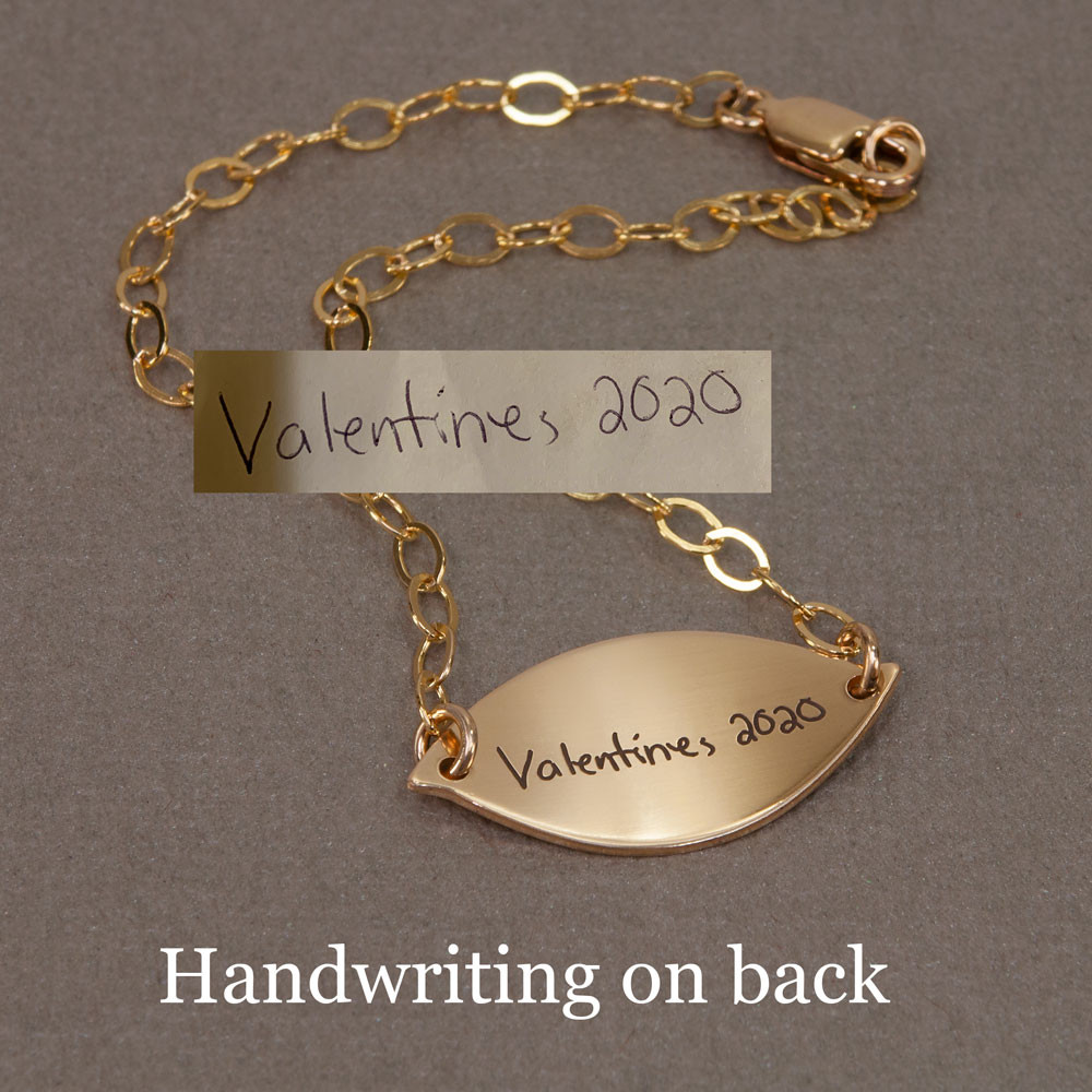 Sweet Petal Gold Handwriting Bracelet, shown with handwriting engraved on back, with original handwriting used to create it