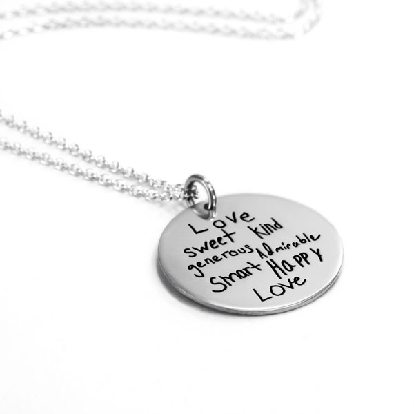 "Your actual handwriting on 7/8"" silver disc necklace, shown on white, from the side"