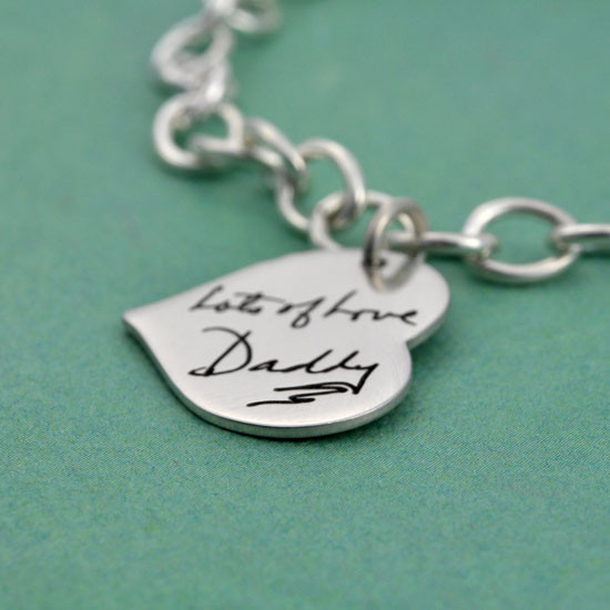 Side view silver heart bracelet with handwriting