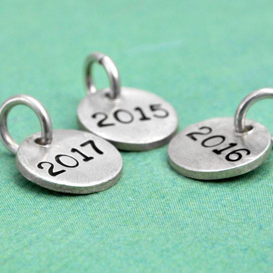Hand stamped silver year charm for teachers and grads, side view
