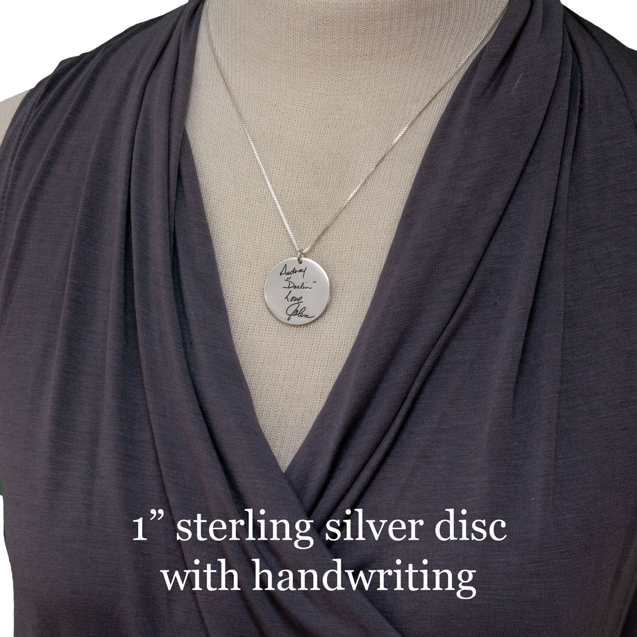 "1"" sterling silver disc with handwriting shown on a model"