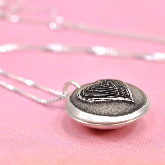 Silver Heart locket for mom with hand stamped message inside, shown from side
