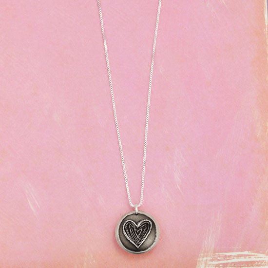 Silver Heart locket for mom with hand stamped message inside, showing chain from above