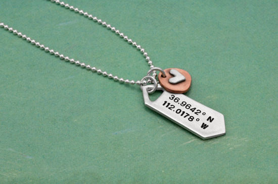 Hand stamped longitude latitude personalized silver necklace, with silver heart on copper disc, shown from side