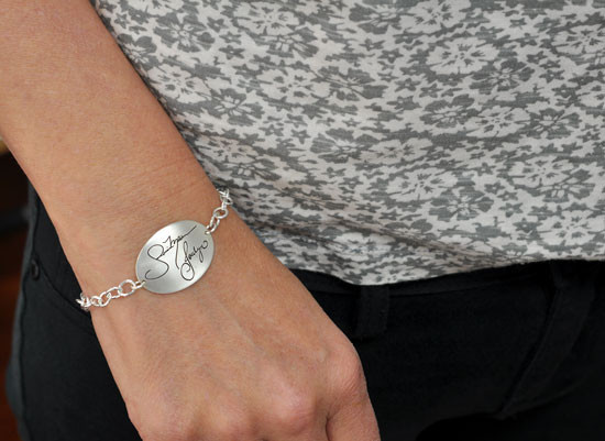Silver handwriting bracelet with actual handwriting shown on model