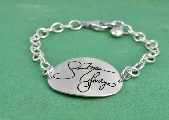 Sterling silver memorial bracelet with handwriting shown from the side