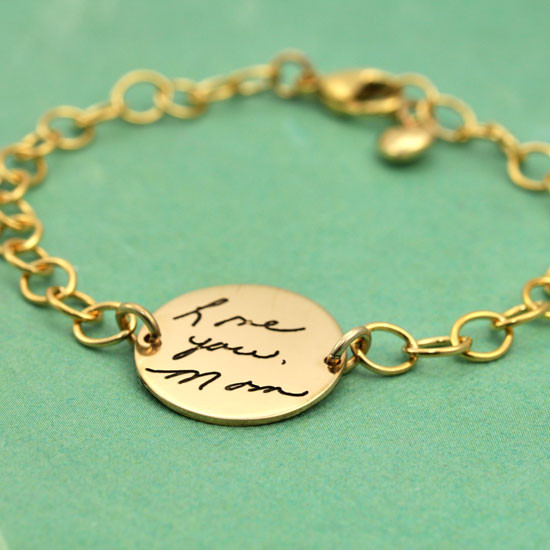 Handwriting personalized gold bracelet , shown on from the side