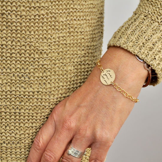 Handwriting personalized gold bracelet , shown on model