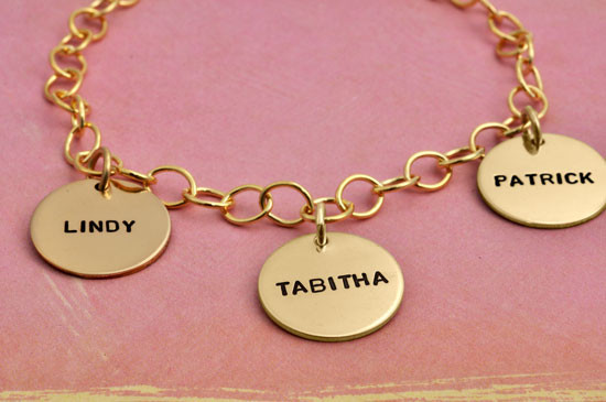 hand stamped gold bracelet for mom with kids' names, shown from the side