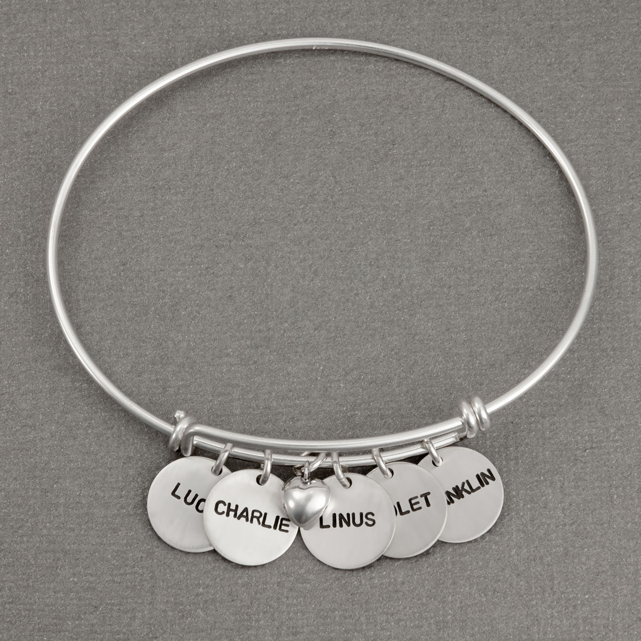 Adjustable silver bracelet with hand stamped charms