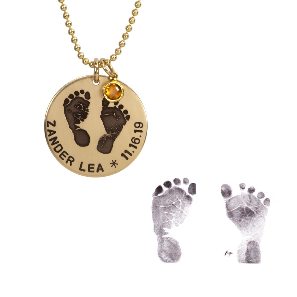 Custom footprints necklace in gold with hand stamping & birthstone, shown with the actual footprints used to create it