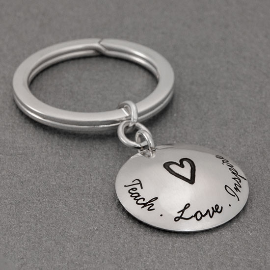 Sterling silver teacher gift for men or women- You Have Made a Difference Key Chain, with words Teach Love Inspire on the front with a heart in the middle. Shown from the side