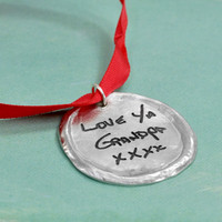 Your handwriting on a personalized ornament made from fine pewter, shown on green