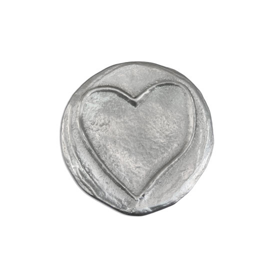 Fine Pewter pocket charm with a raised heart, showing the front