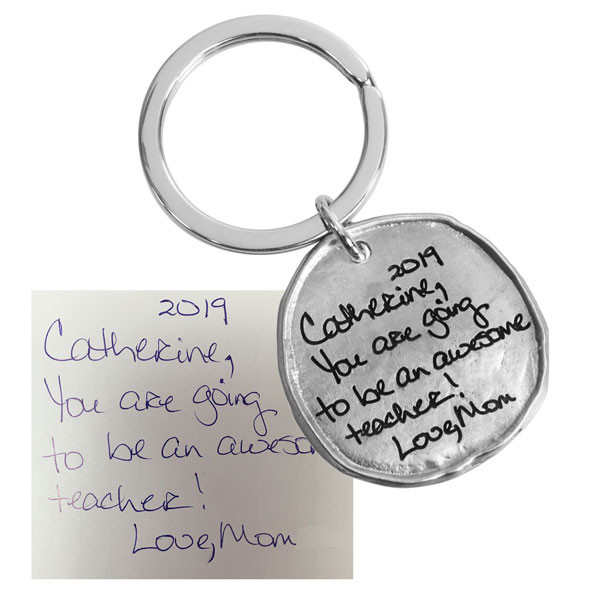 Handwriting on Round Pewter Key Ring with original handwriting