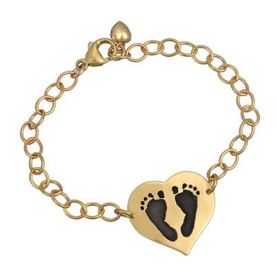Custom footprints on gold bracelet