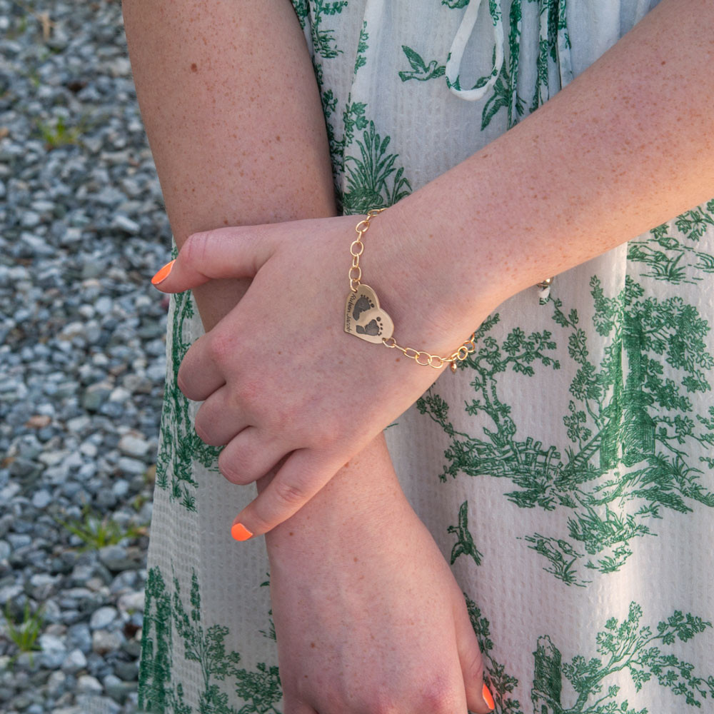 Your baby's actual footprints on custom gold bracelet, shown on model