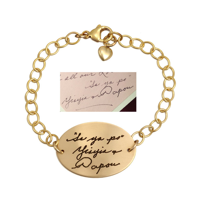 Gold memorial bracelet with your loved ones' actual handwriting, shown with original handwritten note used to create it